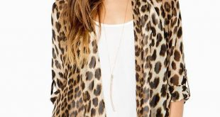 A chiffon cardigan that roars with style! Allover leopard print. Open front. Sha...